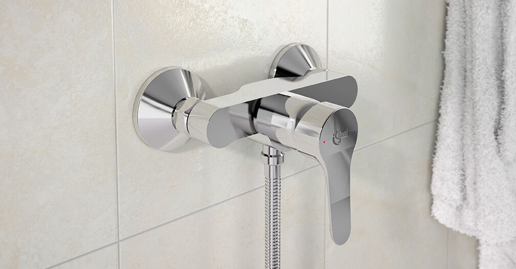 Wall mounted bath mixer with accessories