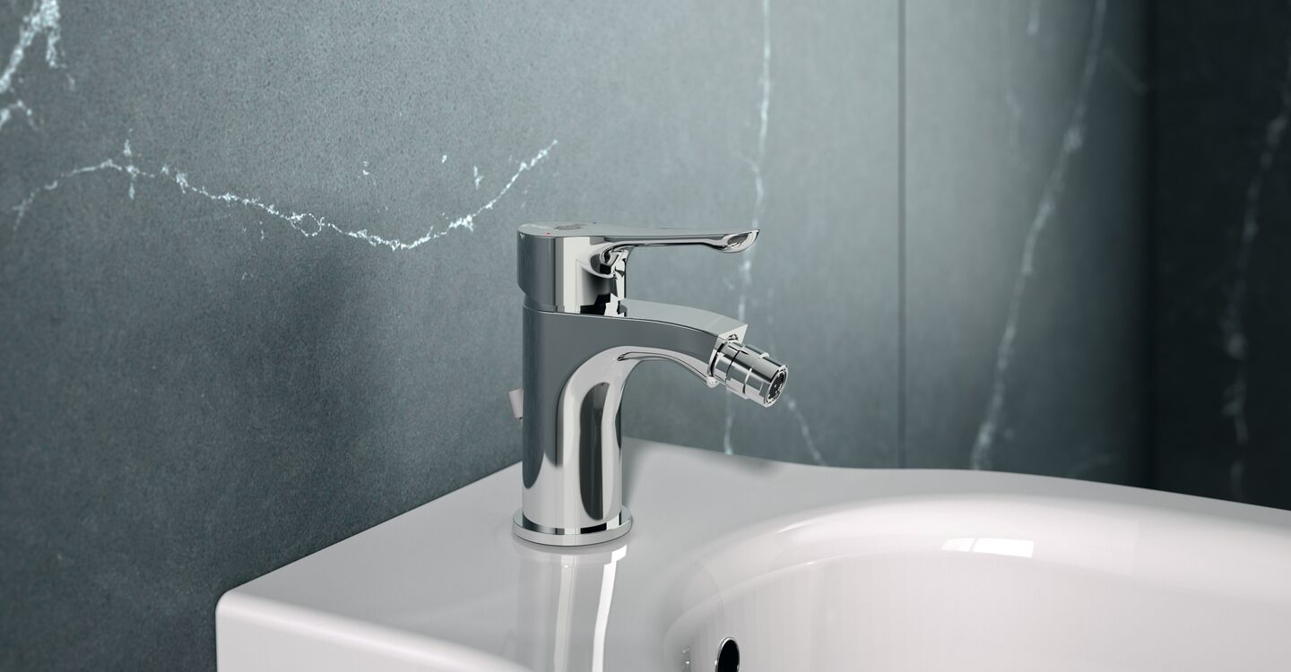 Bidet mixer with plastic pop-up waste